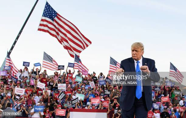 President Donald Trump dances at the end of a rally at Carson City Airport in Carson City, Nevada on October 18, 2020.