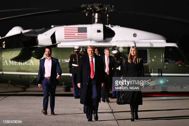 President Donald Trump , daughter Senior Advisor Ivanka Trump and son Donald Trump Jr. Make their way to board Air Force One before departing from...