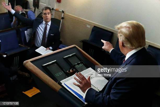 S President Donald Trump debates with NBC News White House Correspondent Peter Alexander during a news briefing on the latest development of the...