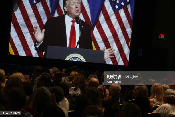 S President Donald Trump deen on a video screen as he addresses the National Association of Realtors Legislative Meetings Trade Expo May 17 2019 in...