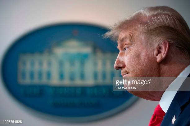 President Donald Trump delivers a news conference in the Brady Briefing Room of the White House in Washington, DC, on July 23, 2020. / The erroneous...