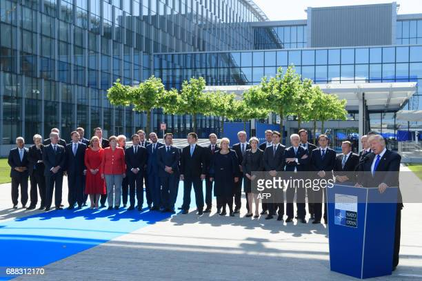 US President Donald Trump delivers a speech as NATO heads of governemts listen during the unveiling ceremony of the new NATO headquarters in Brussels...