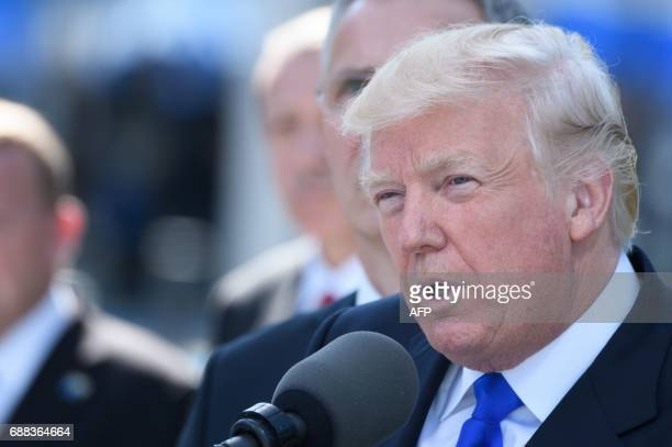 US President Donald Trump delivers a speech during the unveiling ceremony of the new NATO headquarters in Brussels on May 25 during a NATO summit /...