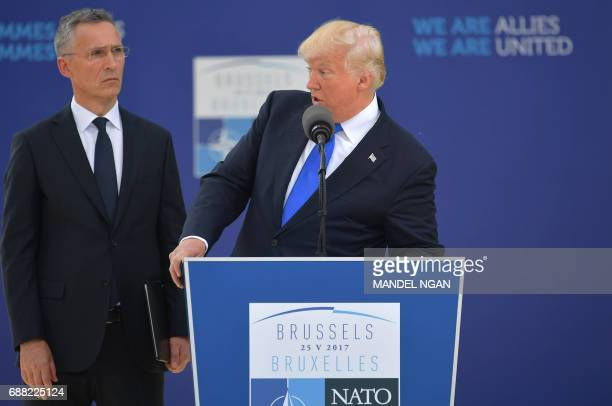 US President Donald Trump delivers a speech next to NATO Secretary General Jens Stoltenberg during the unveiling ceremony of the Berlin Wall monument...