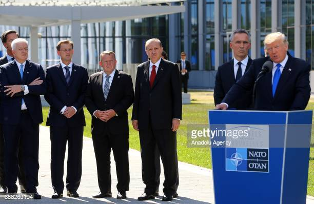 President Donald Trump delivers a speech on the unveiling ceremony of Berlin Wall 9/11 and Article 5 Memorials during the NATO summit at the NATO...