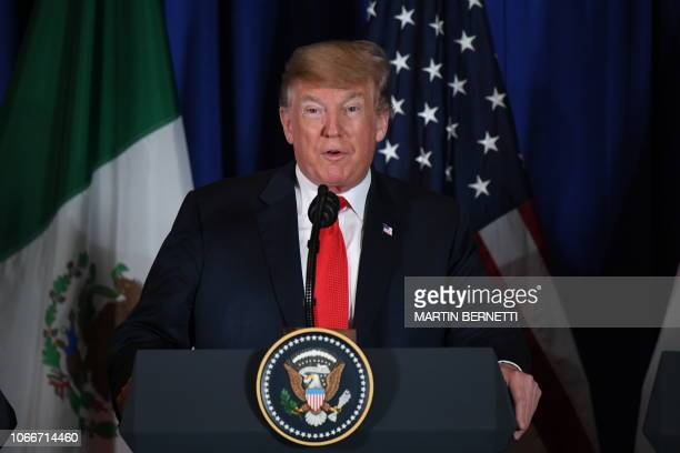 US President Donald Trump delivers a statement along with Mexican President Enrique Pena Nieto and Canadian Prime Minister Justin Trudeau on the...
