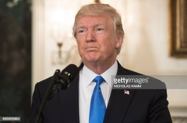 US President Donald Trump delivers a statement in the Diplomatic Room at the White House in Washington DC on June 14 2017 after House Majority Whip...