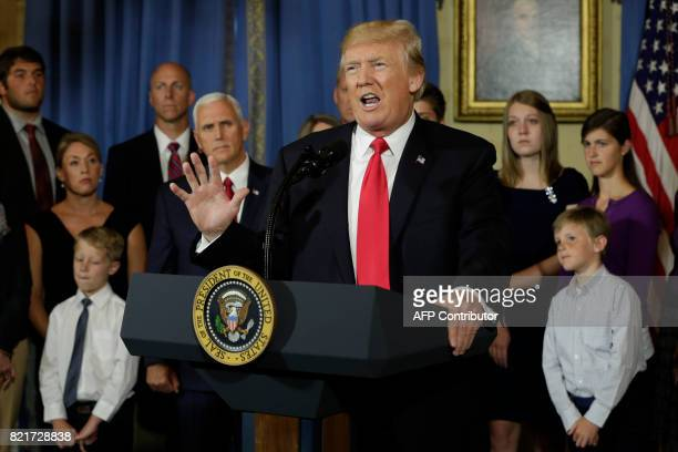 President Donald Trump delivers a statement on healthcare in front of alleged 'victims of Obamacare' at the White House in Washington on July 24 2017...