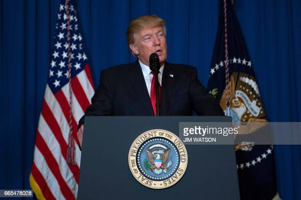 US President Donald Trump delivers a statement on Syria from the MaraLago estate in West Palm Beach Florida on April 6 2017 Trump ordered a massive...