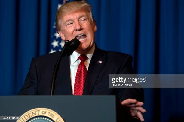 President Donald Trump delivers a statement on Syria from the MaraLago estate in West Palm Beach Florida on April 6 2017 Trump ordered a massive...