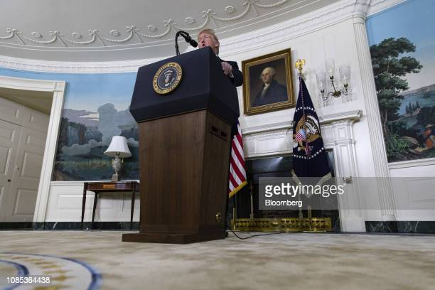 US President Donald Trump delivers a statement on the government shutdown in the Diplomatic Reception Room of the White House in Washington DC US on...