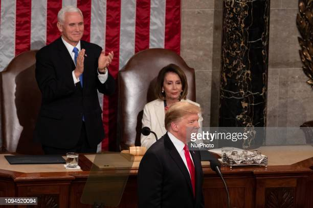 US President Donald Trump delivers his second State of the Union address with Vice President Mike Pence standing to applaud and House Speaker Nancy...