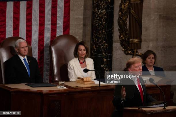 US President Donald Trump delivers his second State of the Union address with Vice President Mike Pence and House Speaker Nancy Pelosi sitting behind...
