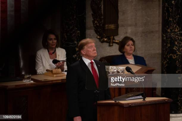 US President Donald Trump delivers his second State of the Union address with House Speaker Nancy Pelosi sitting behind him to a joint session of...