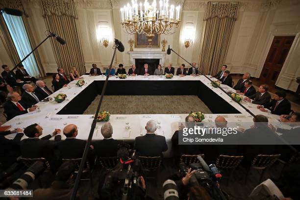President Donald Trump delivers opening remarks at the beginning of a policy forum with business leaders in the State Dining Room at the White House...