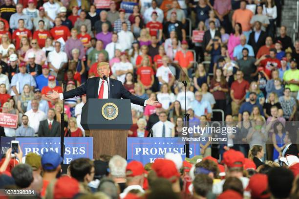 S President Donald Trump delivers remarks at a campaign rally at the Ford Center on August 30 2018 in Evansville Indiana The president was in town to...