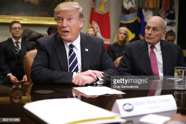 S President Donald Trump delivers remarks at the beginning of a meeting with Homeland Security Secretary John Kelly and other government cyber...
