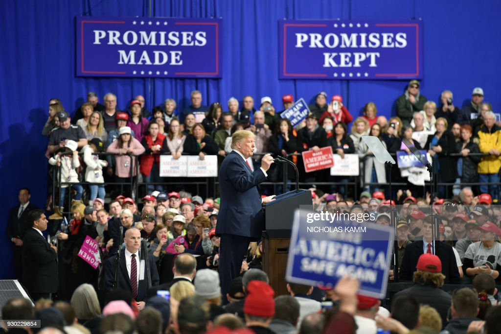 President Donald Trump delivers remarks at the Make America Great Again Rally on March 10, 2018 in Moon Township, Pennsylvania. President Trump travelled to Pennsylvania to speak at a ' Make America Great Again ' rally on behalf of Republican candidate Rick Saccone. / AFP PHOTO / Nicholas Kamm