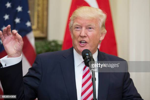 President Donald Trump delivers remarks during a joint statement with President of Turkey Recep Tayyip Erdogan in the Roosevelt Room of the White...