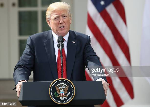 S President Donald Trump delivers remarks during a joint statement with Singapore Prime Minister Lee Hsien Loong in the Rose Garden of the White...