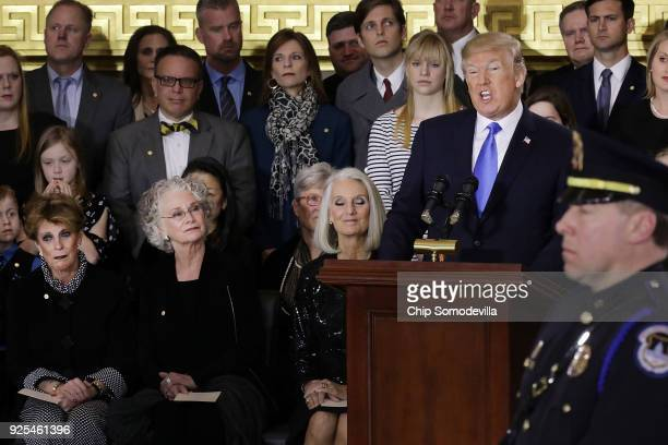 S President Donald Trump delivers remarks during a memorial ceremony for Christian evangelist and Southern Baptist minister Billy Graham as his...