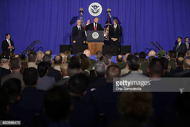 US President Donald Trump delivers remarks during a visit to the Department of Homeland Security with Vice President Mike Pence and Homeland Security...