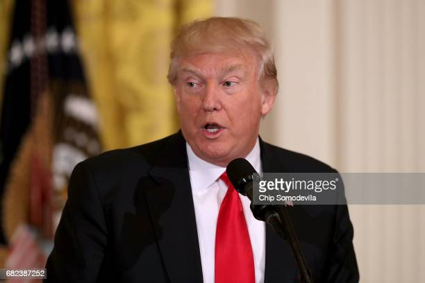 S President Donald Trump delivers remarks during an event for military mothers on National Military Spouse Appreciation Day in the East Room at the...
