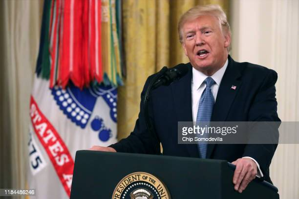 President Donald Trump delivers remarks during the Medal of Honor ceremony for Army Master Sgt. Matthew Williams in the East Room of the White House...