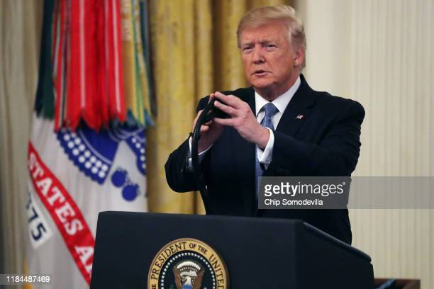 S President Donald Trump delivers remarks during the Medal of Honor ceremony for Army Master Sgt Matthew Williams in the East Room of the White House...