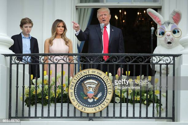 S President Donald Trump delivers remarks from the Truman Balcony with first lady Melania Trump and their son Barron Trump during the 139th Easter...