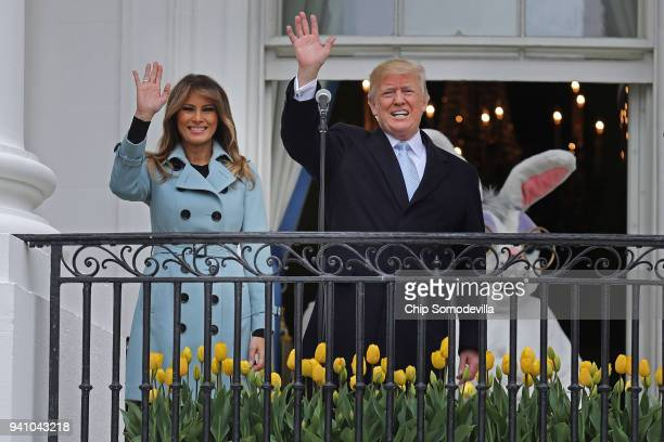 US President Donald Trump delivers remarks from the Truman Balcony with first lady Melania Trump during the 140th annual Easter Egg Roll on the South...
