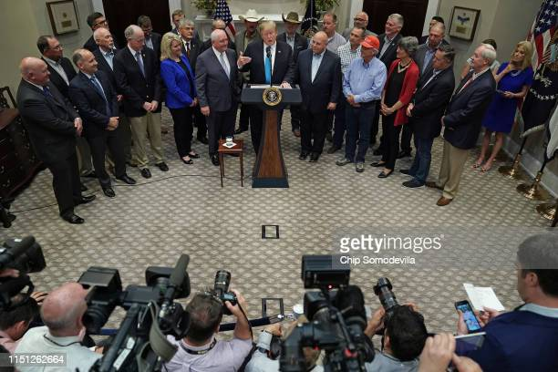S President Donald Trump delivers remarks in support of farmers and ranchers with Agriculture Secretary Sonny Perdue in the Roosevelt Room at the...