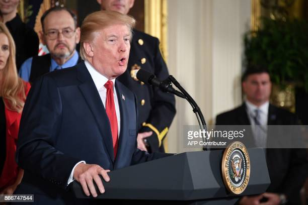 US President Donald Trump delivers remarks on combatting drug demand and the opioid crisis on October 26 2017 in the East Room of the White House in...