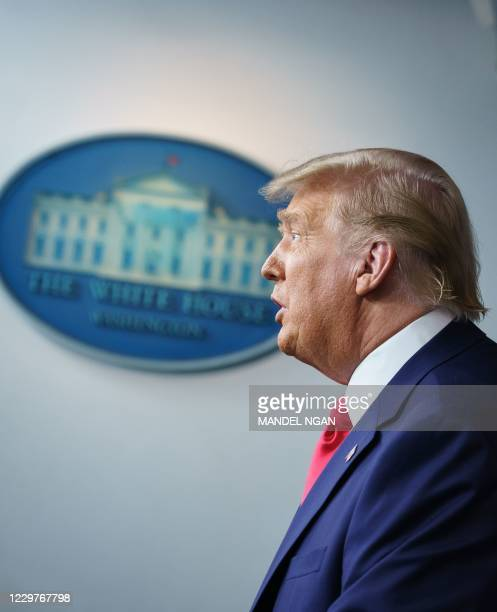 President Donald Trump delivers remarks on the stock market during an unscheduled appearance in the Brady Briefing Room of the White House in...