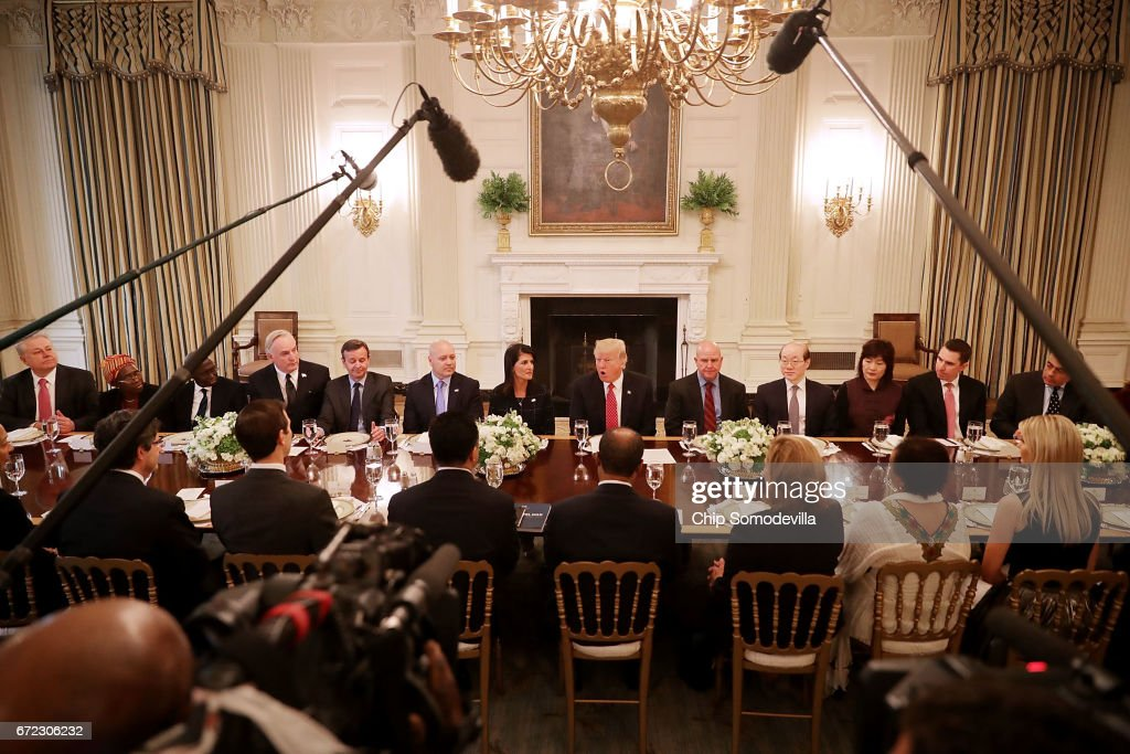 U.S. President Donald Trump (C) delivers remarks while hosting ambassadors from the 15 country members of the United Nations Security Council flanked by his Ambassador to the U.N. Nikki Haley (L) and National Security Advisor H.R. McMaster in the State Dining Room at the White House April 24, 2017 in Washington, DC. Trump was frank in his opening remarks, saying that Haley had briefed him about each member of the council and he said he liked them all.