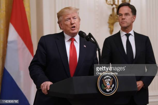 S President Donald Trump delivers remarks with Dutch Prime Minister Mark Rutte during a ceremony where a flag from DDay was donated to the...