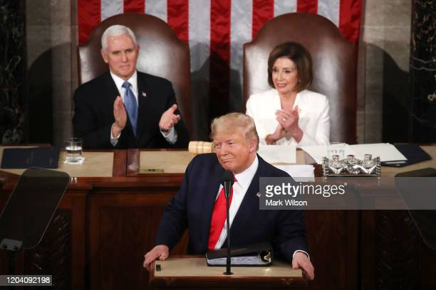 President Donald Trump delivers the State of the Union address as House Speaker Rep Nancy Pelosi and Vice President Mike Pence look on in the chamber...