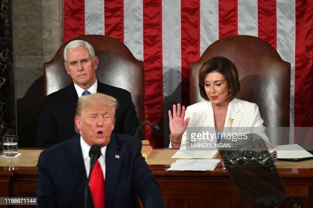 President Donald Trump delivers the State of the Union address flanked by US Vice President Mike Pence and Speaker of the US House of Representatives...