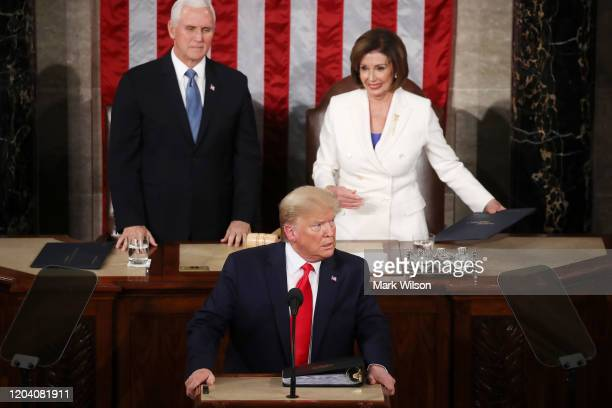 President Donald Trump delivers the State of the Union address House Speaker Rep. Nancy Pelosi and Vice President Mike Pence look on in the chamber...