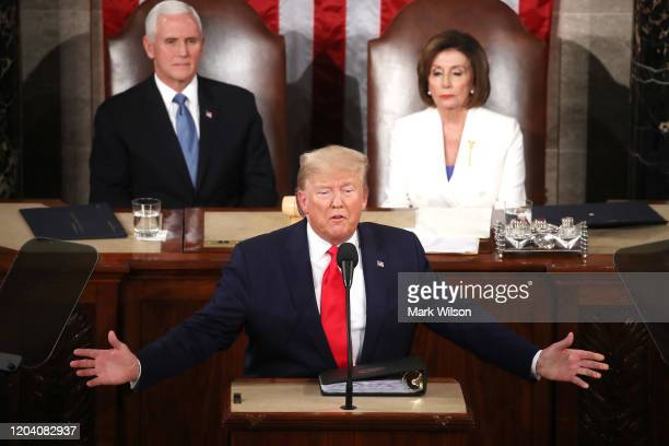 President Donald Trump delivers the State of the Union address House Speaker Rep Nancy Pelosi and Vice President Mike Pence look on in the chamber of...