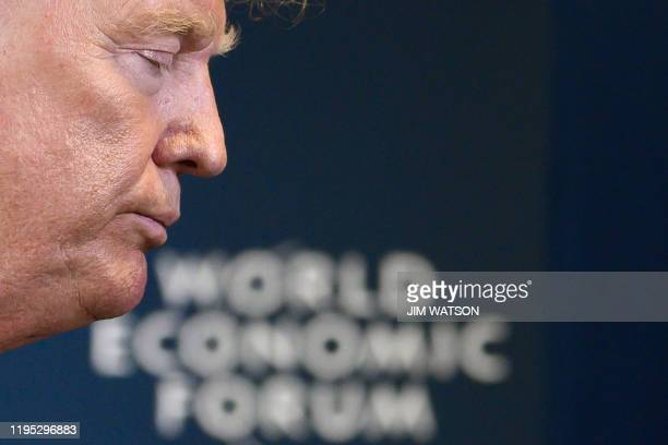 President Donald Trump departs a press conference at the World Economic Forum in Davos, Switzerland, on January 22, 2020.