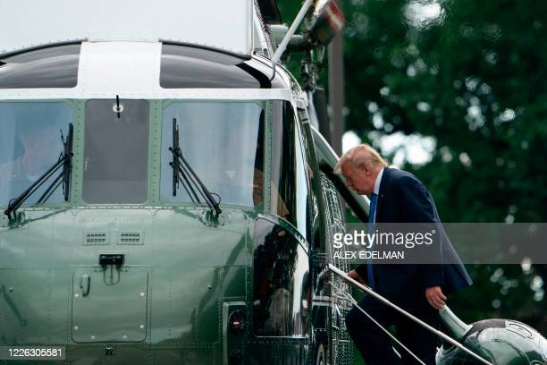 US President Donald Trump departs aboard Marine One after visiting Walter Reed National Military Medical Center in Bethesda Maryland on July 11 2020