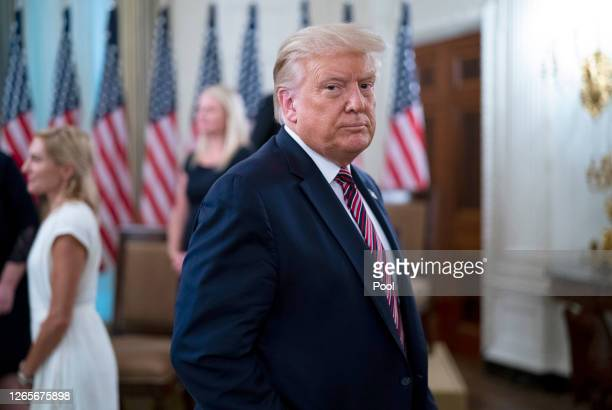 "President Donald Trump departs an event titled ""Kids First: Getting America's Children Safely Back to School"" August 12, 2020 in the State Dining..."