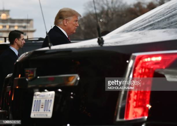 US President Donald Trump departs Blair House opposite the presidential mansion after visting former US President George W Bush and his wife former...