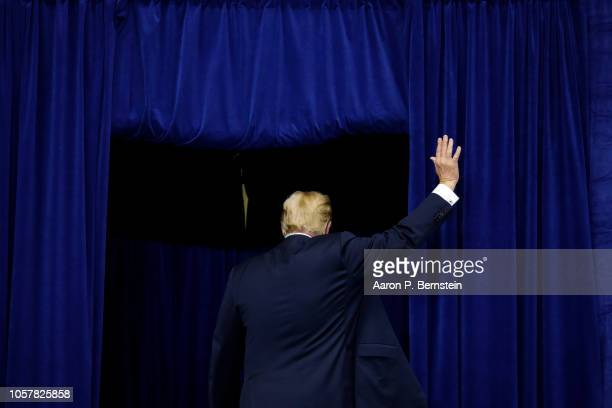 President Donald Trump departs following a campaign rally for Republican Senate candidate Mike Braun at Allen County War Memorial Coliseum November 5...