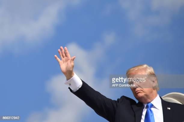US President Donald Trump departs from Andrews Air Force base in Arlington Virginia near Washington DC on October 25 as he travels to Dallas to...
