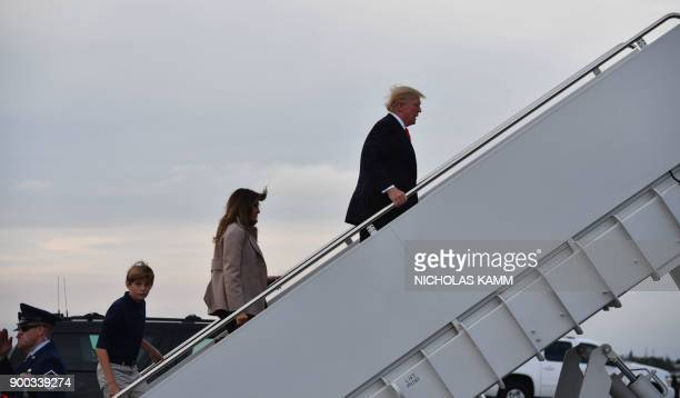US President Donald Trump departs from West Palm Beach Florida with First Lady Melania Trump and son Barron Trump en route to Washington DC on...