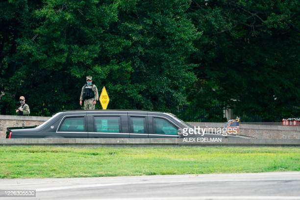 US President Donald Trump departs in his motorcade after a visit to Walter Reed National Military Medical Center in Bethesda Maryland' on July 11 2020