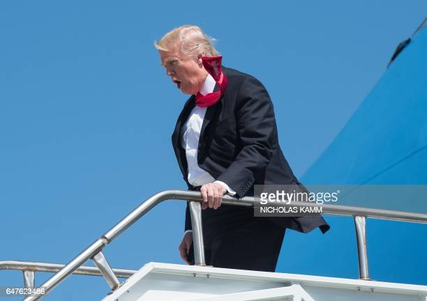 President Donald Trump departs off Air Force One after arriving in Orlando Florida on March 3 before heading to St Andrew Catholic School / AFP PHOTO...
