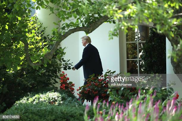 S President Donald Trump departs the White House on his way to West Virginia on August 3 2017 in Washington DC A grand jury has been impaneled by...